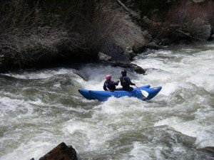Dawn and Ethan R2'ing on the Lake Fork of the Gunnison River
