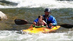Ethan giving their daughter, Josie, a little taste of kayaking.