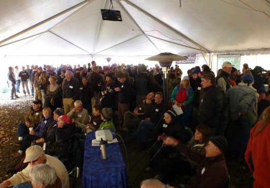 Hundreds of people gathered around 5 screens under the big tent to watch Condit Dam BLOW!