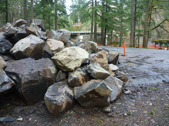Giant boulders wait to be placed in the new take-out at Northwestern Lake Park.