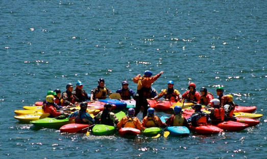 Kayakers learn skills at Rowland Lake during a beginner kayak course.
