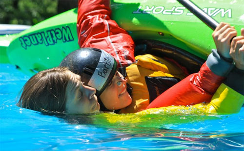 Learning to remain calm underwater during a beginner kayak course