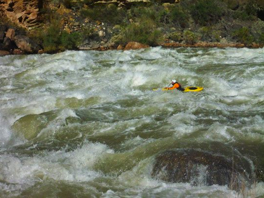Paddling a fully-loaded boat on a self support kayak trip can be awkward at first, but proves to be an asset in rapids like Lava Falls on the Grand Canyon