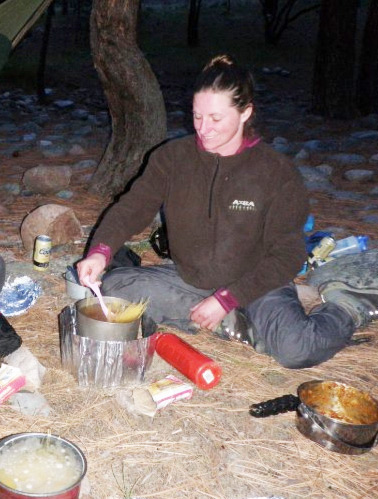 With less equipment to deal with, cooking on a self support kayak trip is easy and quick. The author is looking forward to eating her dehydrated lasagna after a day on the Middle Fork of the Salmon River in Idaho.