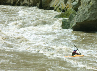 Nicki paddling strong through Montgomery Rapid, high water on the Owyhee River Wet Planet staff trip 2011