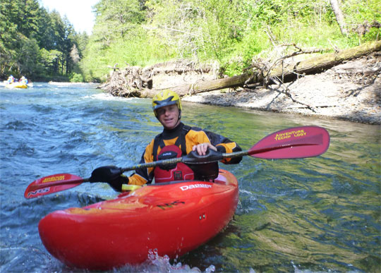 Dave Steindorf, Stweardship Director with American Whitewater, enjoys the river from a kayak.