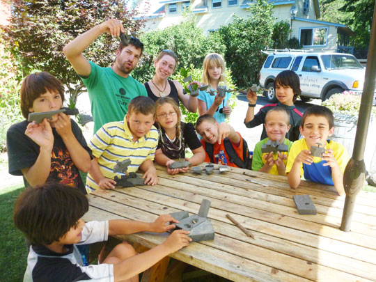 Making foamy boaters during 2011 Summer Kids Kayak Course at Wet Planet.