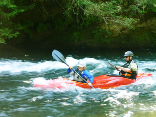 Curt takes each student for the surf of their lives at the cave wave on the Lower White Salmon River
