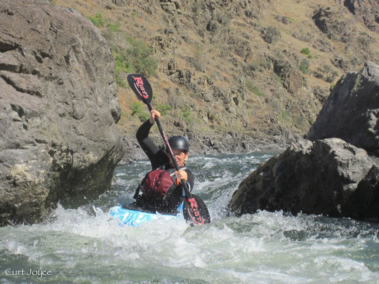 Faith hits the perfect stroke on the Lower Salmon kayak course.