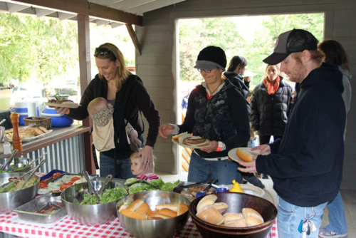Community members enjoy a Wet Planet BBQ with raft guides.