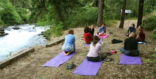 Yoga by the river during the Yoga + Kayak Immersion at Wet Planet Whitewater