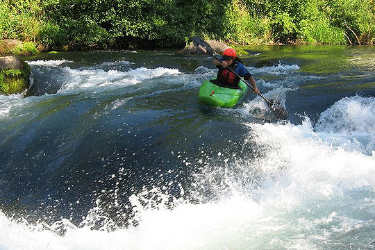 Temira takes on Rattlesnake Rapid on the White Salmon River, WA