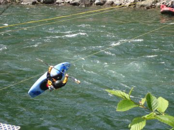 Whitewater Kayaker getting big air at Clack fest in Oregon