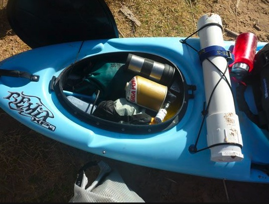 Filling a hatch with odds and ends during a multi day self support kayak trip helps use every bit of space possible.