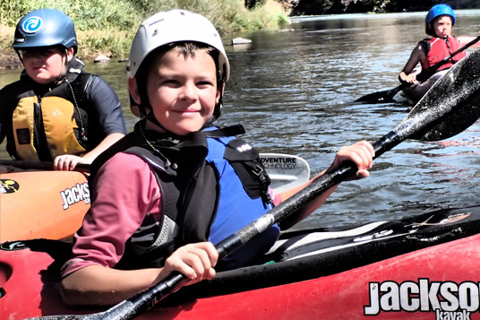 Kids learning to kayak at the lake with Wet Planet