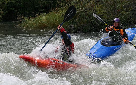 Kayaking through waves on the Tieton River