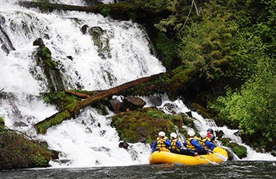 Klickitat river rafting with a waterfall view.