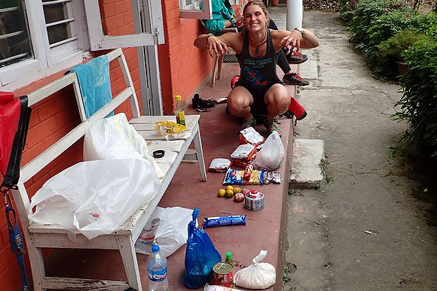 Libby packing food for a multi-day self-support kayak trip on the Kaligandaki.