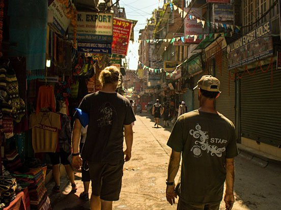 John and Todd walking in the allies of Thamel.