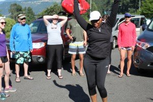 First Descents participants and staff, and Wet Planet staff, dance in the parking lot of the Washington Park-and-Ride after a day of kayaking
