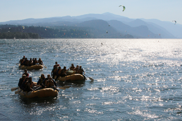 Wet Planet rafts surrounded by kiteboarders after a day of whitewater rafting on the White Salmon River