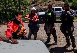 Wet Planet Kayak Instructor Gynner Paris uses his surroundings to teach class on eddy turns.