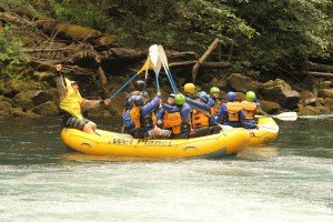 Banana goes for a paddle high-five with the First Descents crew on the White Salmon River
