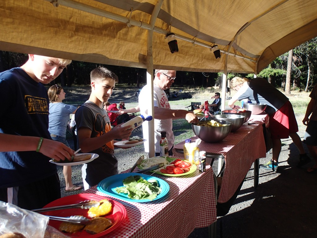 Wet Planet staff serves up BBQ lunch and dinner at their Tieton base camp.