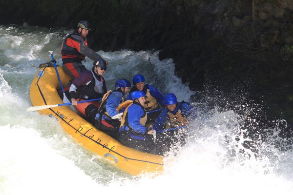 Rafters go through Top Drop on the White Salmon River.