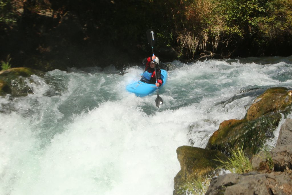 Naomi showing her passion for whitewater on Husum Falls on the White Salmon River
