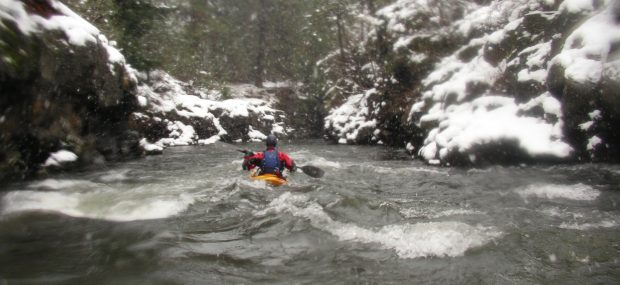whitewater kayaking in snowy winter conditions with Wet Planet